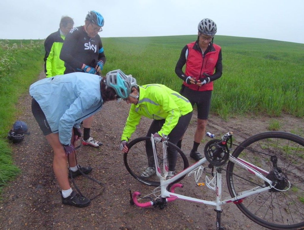 Good to see the ladies taking an interest in puncture repairs whilst the men just watch!